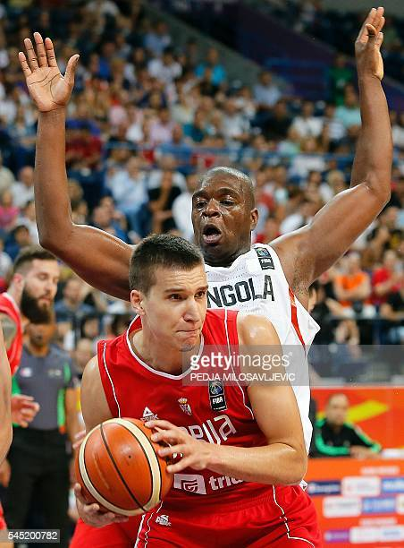 Serbia's Bogdan Bogdanovic vies with Angola's Felizardo Ambrosio during the 2016 FIBA World Olympic Qualifying basketball match between Angola and...