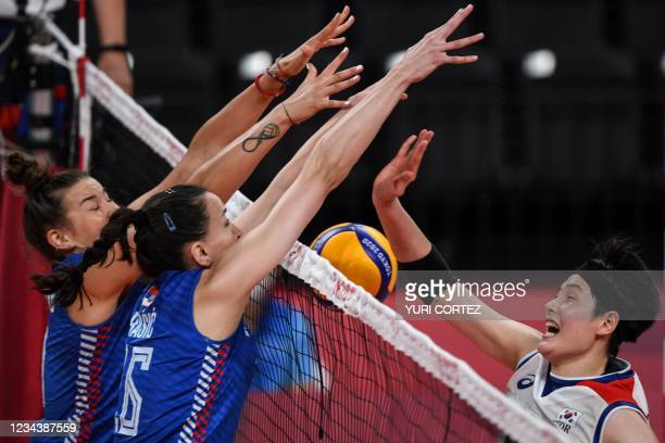 Serbia's Bojana Milenkovic and Milena Rasic block a shot from South Korea's Kim Hee-jin in the women's preliminary round pool A volleyball match...