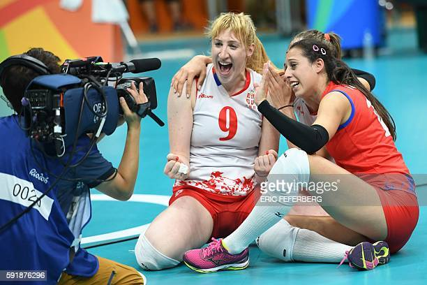 Serbia's Brankica Mihajlovic and Serbia's Silvija Popovic wave to the camera after winning the women's semifinal volleyball match against USA at the...