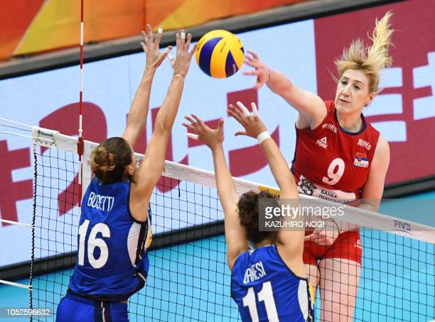 Serbia's Brankica Mihajlovic spikes the ball over Italy's Lucia Bosetti and Anna Danesi during the 2018 FIVB World Championship volleyball women's...