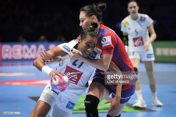 Serbia's center back Tamara Radojevic vies with France's center back Estelle Nze Minko during the Women Euro 2018 handball Championships Group 1 main...