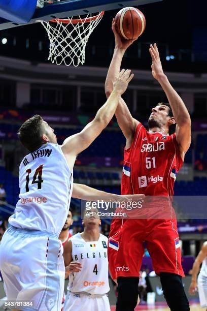 Serbia's center Boban Marjanovic goes to the basket despite Belgium's power forward Maxime De Zeeuw during the men's FIBA Eurobasket 2017 group D...