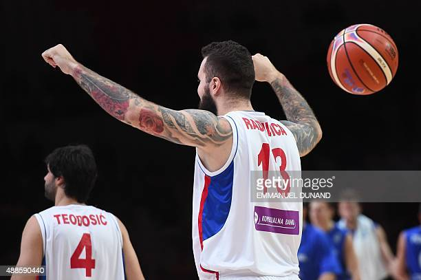 Serbia's center Miroslav Raduljica celebrates after Serbia defeated the Czech republic in their round of 8 basketball match at the EuroBasket 2015 in...