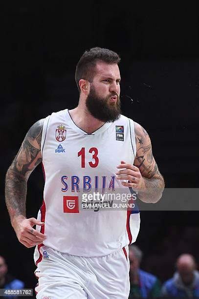Serbia's center Miroslav Raduljica looks on during the round of 8 basketball match between Serbia and the Czech Republic at the EuroBasket 2015 in...