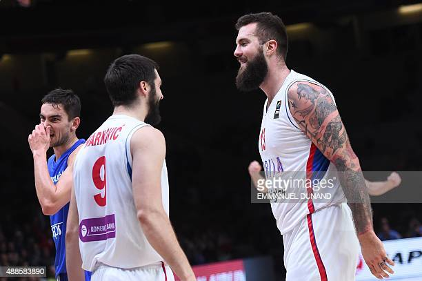 Serbia's center Miroslav Raduljica reacts with Serbia's point guard Stefan Markovic during the round of 8 basketball match between Serbia and the...