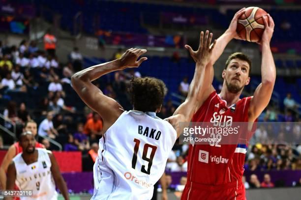 Serbia's center Ognjen Kuzmic vies for the ball with Belgium's center Ismael Bako during the FIBA Eurobasket 2017 men's group D basketball match...
