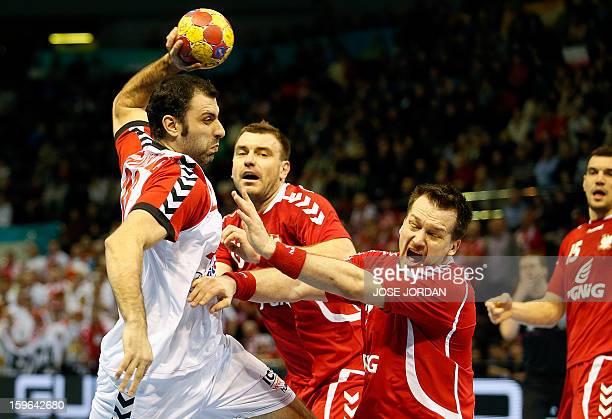 Serbia's centre back Nenad Vuckovic vies with Poland's centre back Michal Kubisztal during the 23rd Men's Handball World Championships preliminary...
