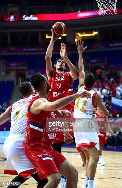 Serbia`s centre Boban Marjanovic shoots past Russia`s Semen Antonov and forward Andrey Zubkov during the FIBA Eurobasket 2017 men`s group D...