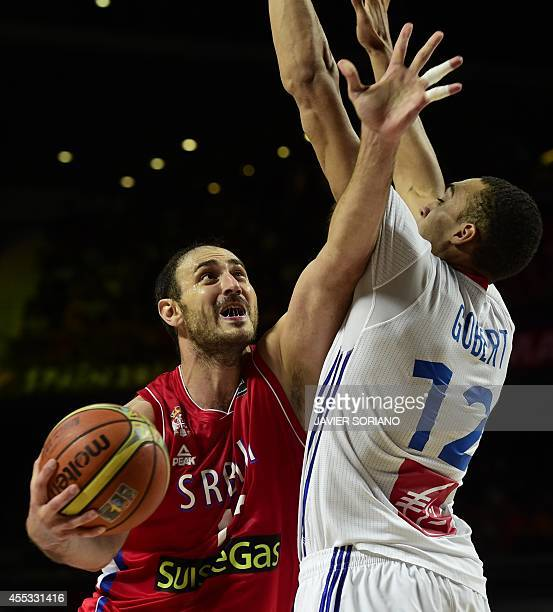Serbia's centre Nenad Krstic vies with France's centre Rudy Gobert during the 2014 FIBA World basketball championships semifinal match France vs...