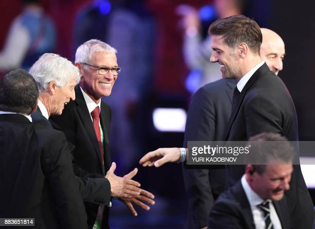 Serbia's coach Mladen Krstajic shakes hands with Columbia's national football team coach Jose Pekerman next to Egypt's Argentinian coach Hector Cuper...