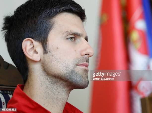 Serbia's Davis Cup team player Novak Djokovic looks on during the official draw ceremony ahead of the World Group Davis Cup tie between Serbia and...