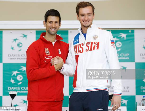 Serbia's Davis Cup team player Novak Djokovic shake hands with the Russia Davis Cup player Daniil Medvedev during the official draw ceremony ahead of...
