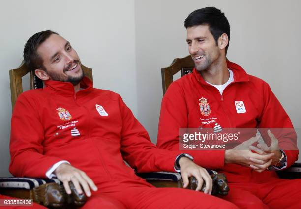 Serbia's Davis Cup team players Viktor Troicki and Novak Djokovic smile during the official draw ceremony ahead of the World Group Davis Cup tie...