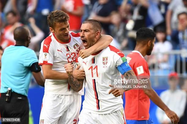 Serbia's defender Aleksandar Kolarov is congratulated by Serbia's midfielder Adem Ljajic after scoring during the Russia 2018 World Cup Group E...