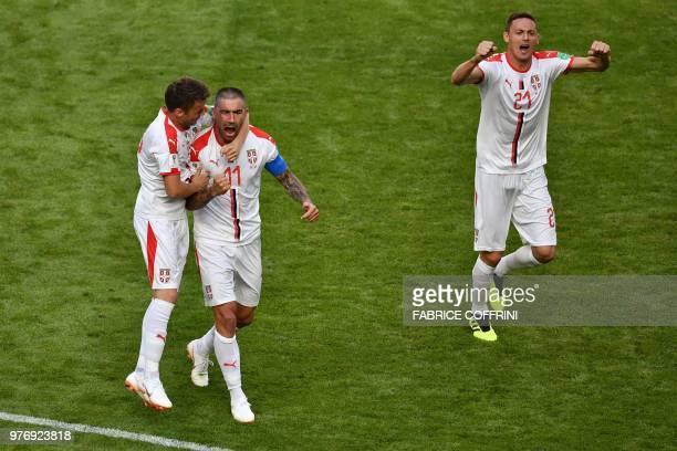TOPSHOT Serbia's defender Aleksandar Kolarov is congratulated by Serbia's midfielder Adem Ljajic after scoring during the Russia 2018 World Cup Group...
