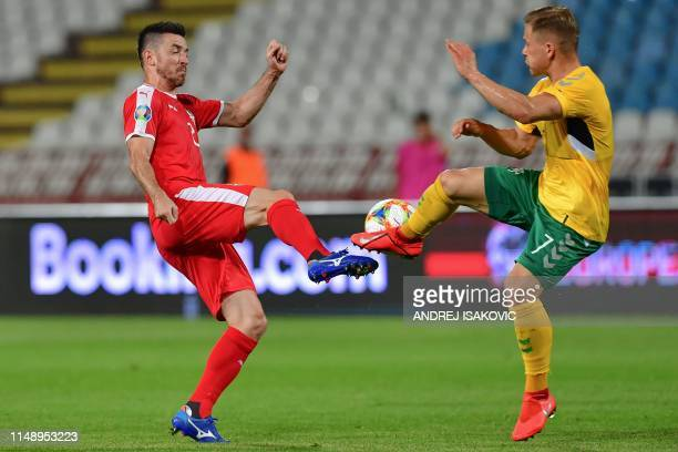 Serbia's defender Antonio Rukavina fights for the ball with Lithuania's midfielder Domantas Simkus during the Euro 2020 football qualification match...