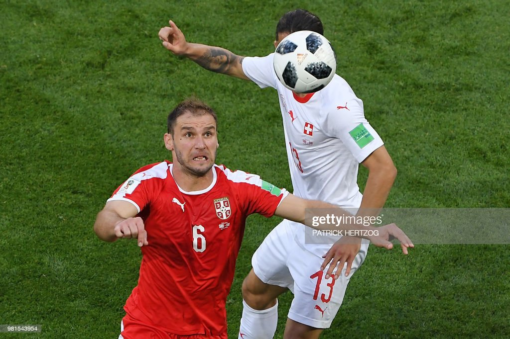 TOPSHOT - Serbia's defender Branislav Ivanovic (L) vies for the ball with Switzerland's defender Ricardo Rodriguez during the Russia 2018 World Cup Group E football match between Serbia and Switzerland at the Kaliningrad Stadium in Kaliningrad on June 22, 2018. (Photo by Patrick HERTZOG / AFP) / RESTRICTED