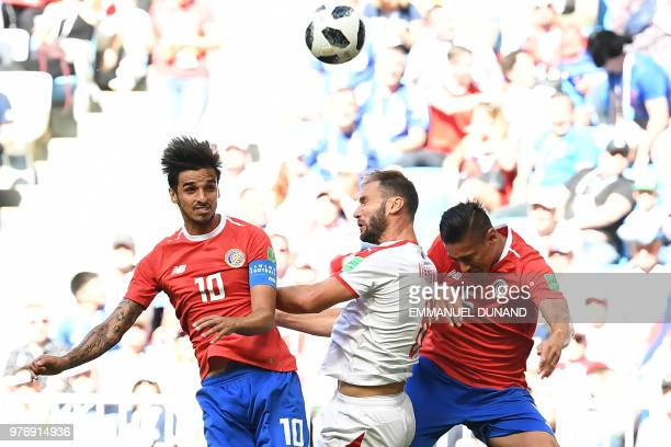 TOPSHOT Serbia's defender Branislav Ivanovic vies for the header with Costa Rica's midfielder Bryan Ruiz and Costa Rica's midfielder Celso Borges...