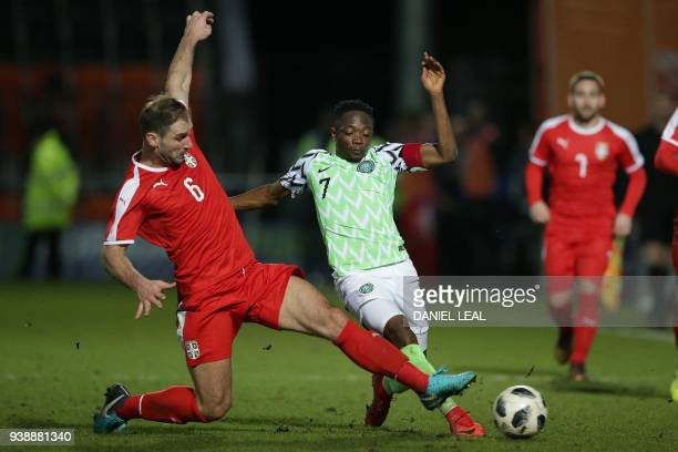 Serbia's defender Branislav Ivanovic vies with Nigeria's striker Ahmed Musa during the International friendly football match between Nigeria and...