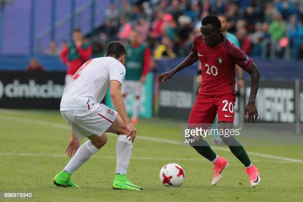 Serbia's defender Milan Gajic and Portugal's midfielder Bruma vie for the ball during the UEFA U21 European Championship Group B football match...