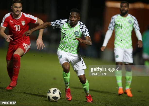 Serbia's defender Nikola Maksimovic vies with Nigeria's striker Ahmed Musa during the International friendly football match between Nigeria and...