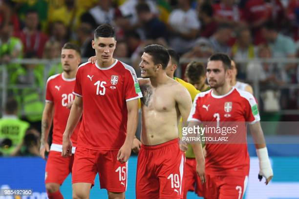 Serbia's defender Nikola Milenkovic and Serbia's forward Luka Jovic look dejected at the end of the Russia 2018 World Cup Group E football match...