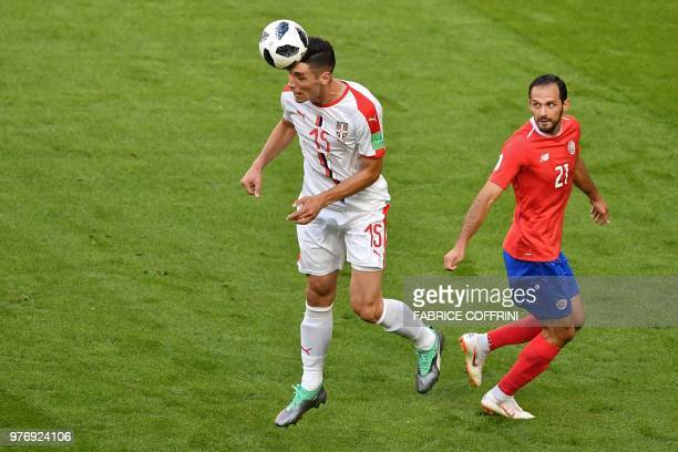 Serbia's defender Nikola Milenkovic heads the ball before Costa Rica's forward Marco Urena during the Russia 2018 World Cup Group E football match...