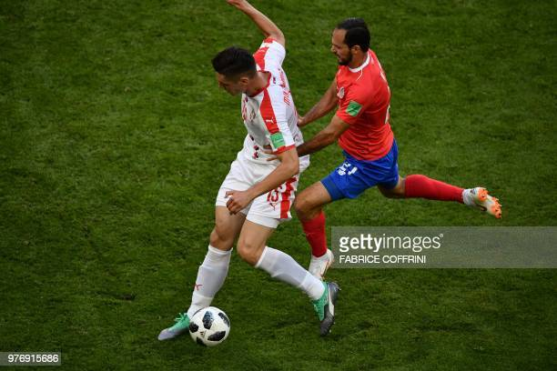 Serbia's defender Nikola Milenkovic is marked by Costa Rica's forward Marco Urena during the Russia 2018 World Cup Group E football match between...