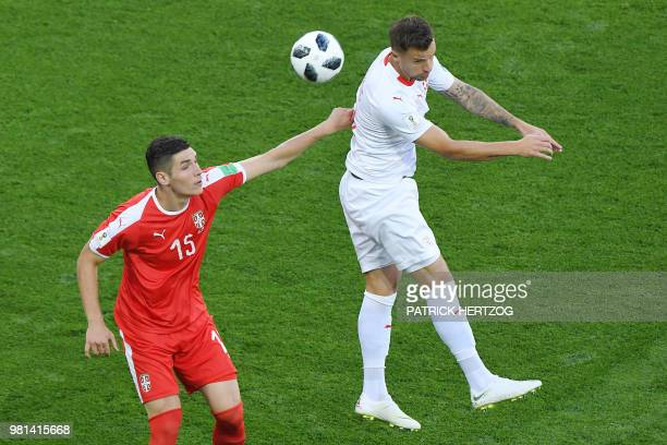 Serbia's defender Nikola Milenkovic vies for the ball with Switzerland's forward Haris Seferovic during the Russia 2018 World Cup Group E football...