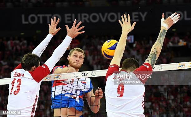 Serbia's Drazen Luburic spikes against Poland's Bartlomiej Lemanski and Michal Kubiak during the opening match between Poland and Serbia of the 2017...
