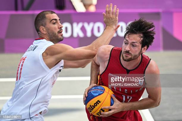 Serbia's Dusan Domovic Bulut fights for the ball with Belgium's Thierry Marien during the men's first round 3x3 basketball match between Serbia and...