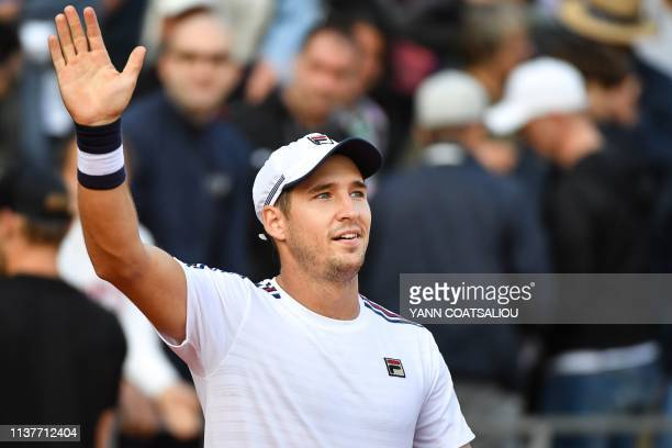 Serbia's Dusan Lajovic celebrates after winning against Belgium's David Goffin during their tennis match on the day 5 of the MonteCarlo ATP Masters...