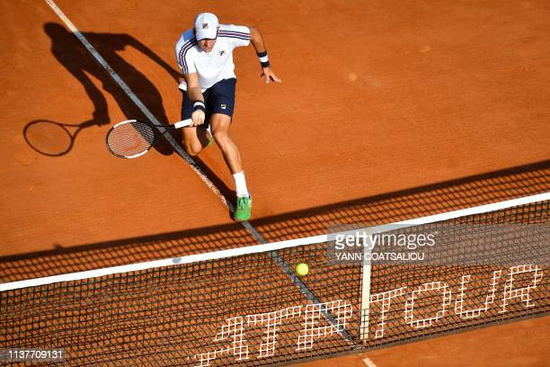 Serbia's Dusan Lajovic plays a forehand return to Belgium's David Goffin during their tennis match on the day 5 of the MonteCarlo ATP Masters Series...