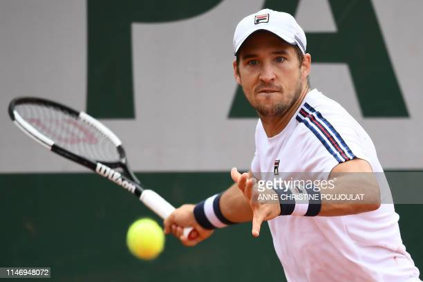 Serbia's Dusan Lajovic returns the ball to France's Elliot Benchetrit uring their men's singles second round match on day five of The Roland Garros...