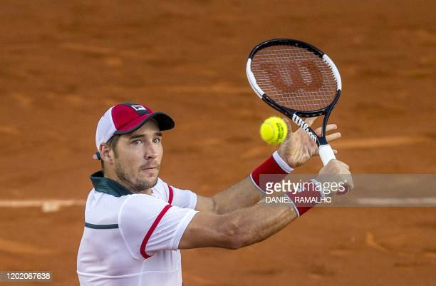Serbia's Dusan Lajovic returns the ballduring his ATP World Tour Rio Open 2020 tournament match against Italy's Lorenzo Sonego at the Jockey Club in...