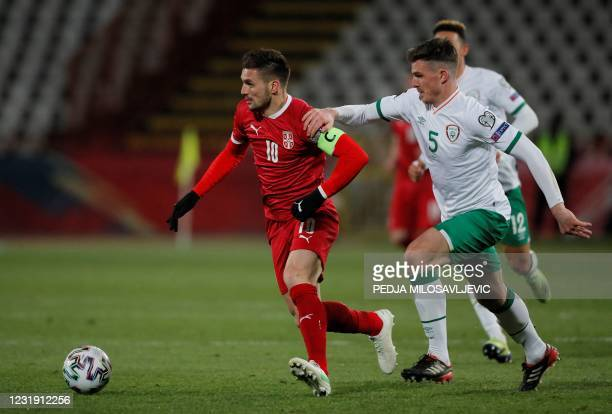 Serbia's Dusan Tadic fights for the ball with Ireland's Ciaran Clark during the FIFA World Cup Qatar 2022 qualification football match between Serbia...