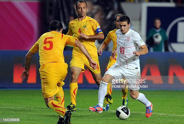 Serbia's Dusan Tadic vies with Macedonia's Boban Grncarov during their FIFA 2014 World Cup qualifying football match at Filip 2 Stadium in Skopje on...