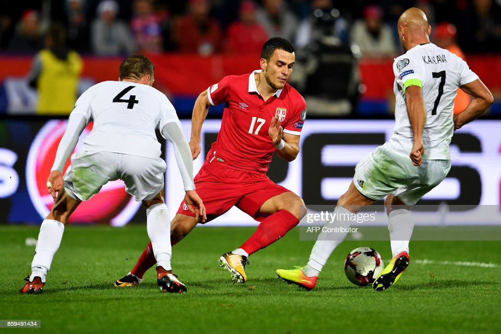 Serbia's Filip Kostic (C) vies with Georgia's Guram Kashia (L) and Jaba Kankava during the FIFA World Cup 2018 qualification football match between Serbia and Georgia at the Rajko Mitic stadium in Belgrade on October 9, 2017. /