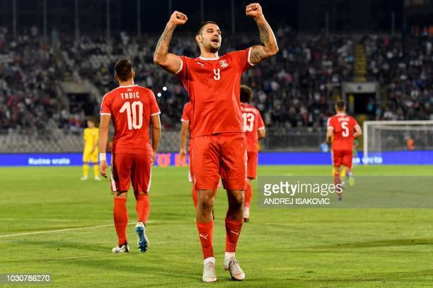 Serbia's forard Aleksandar Mitrovic celebrates after scoring a goal during the UEFA Nations League football match between Serbia and Romania at the...