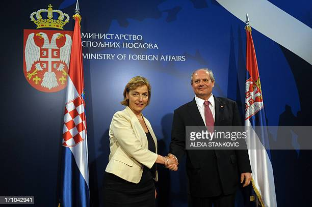 Serbia's Foreign Minister Ivan Mrkic welcomes his Croatia's counterpart Vesna Pusic prior to their meeting in Belgrade on June 21 2013 AFP PHOTO /...