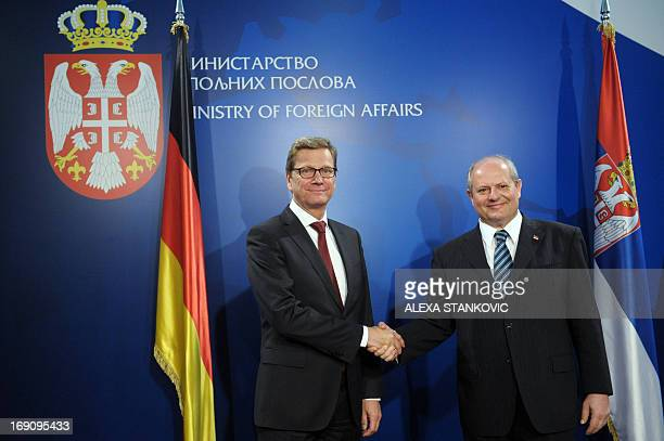 Serbia's Foreign Minister Ivan Mrkic welcomes his Germany's counterpart Guido Westerwelle pror to their meeting in Belgrade on May 20 2013 German...