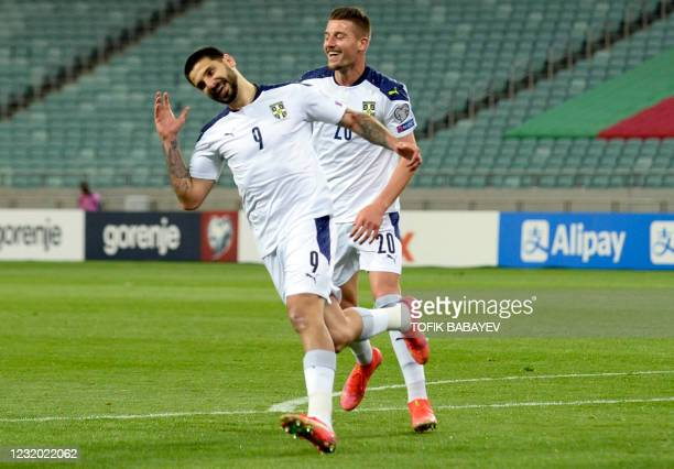 Serbia's forward Aleksandar Mitrovic celebrates after scoring the opening goal during the FIFA World Cup Qatar 2022 qualification football match...