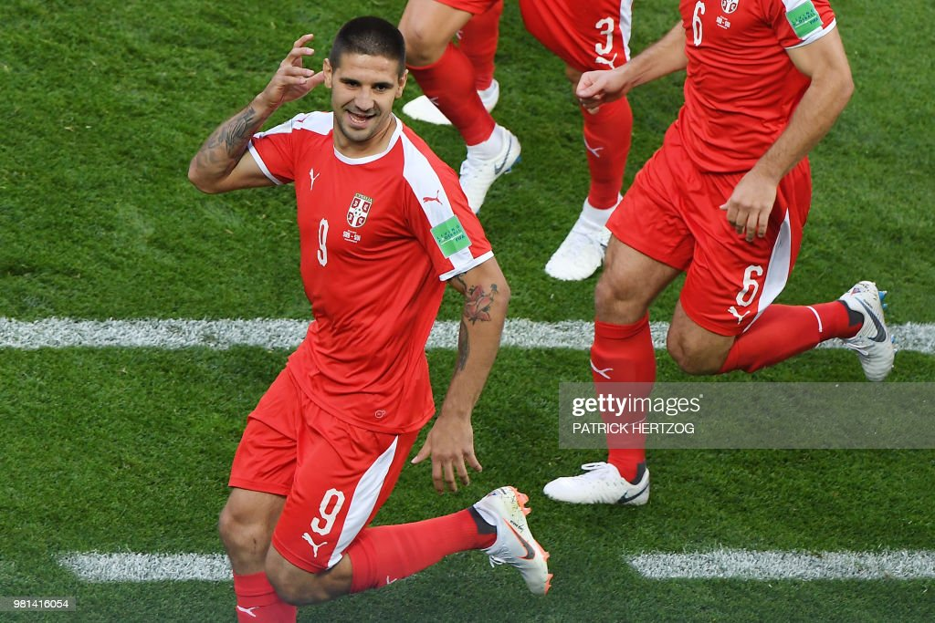 Serbia's forward Aleksandar Mitrovic (L) celebrates after scoring the opening goal during the Russia 2018 World Cup Group E football match between Serbia and Switzerland at the Kaliningrad Stadium in Kaliningrad on June 22, 2018. (Photo by Patrick HERTZOG / AFP) / RESTRICTED