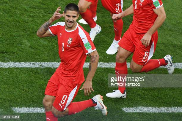 Serbia's forward Aleksandar Mitrovic celebrates after scoring the opening goal during the Russia 2018 World Cup Group E football match between Serbia...