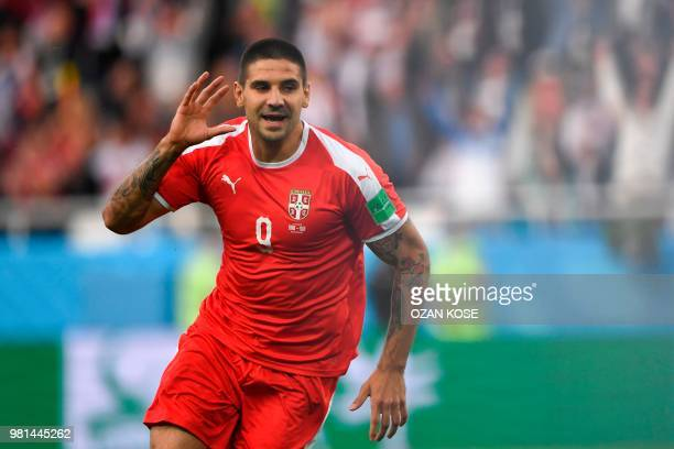 Serbia's forward Aleksandar Mitrovic celebrates scoring during their Russia 2018 World Cup Group E football match between Serbia and Switzerland at...