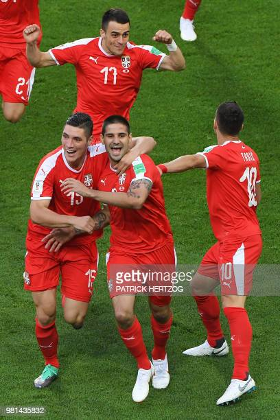 Serbia's forward Aleksandar Mitrovic celebrates with teammates after scoring the opening goal during the Russia 2018 World Cup Group E football match...