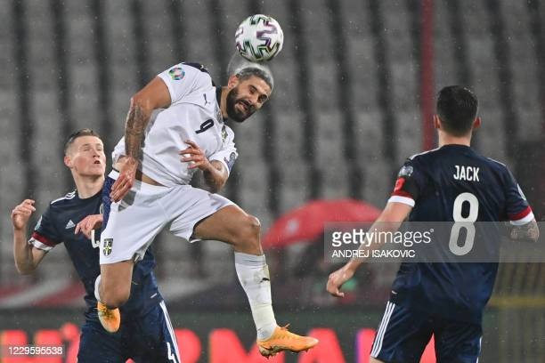Serbia's forward Aleksandar Mitrovic heads the ball against Scotland's midfielder Scott McTominay during the Euro 2020 play-off qualification...