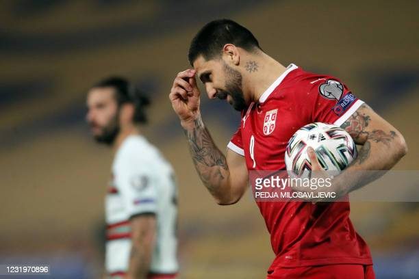 Serbia's forward Aleksandar Mitrovic reacts after scoring a goal during the FIFA World Cup Qatar 2022 qualification Group A football match between...