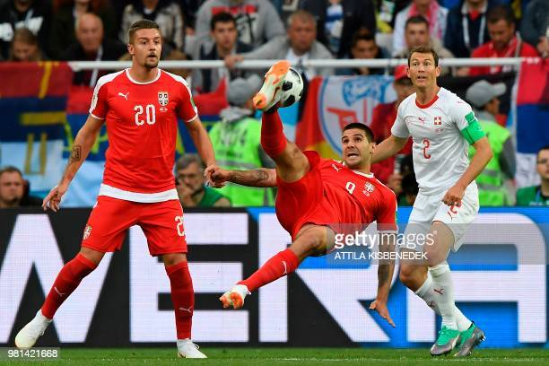 Serbia's forward Aleksandar Mitrovic strikes the ball during their Russia 2018 World Cup Group E football match between Serbia and Switzerland at the...
