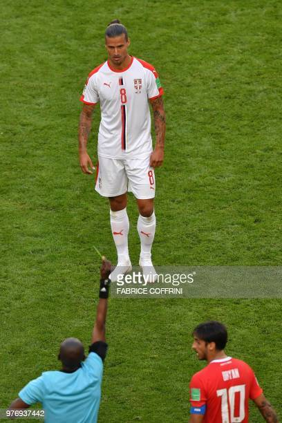 Serbia's forward Aleksandar Prijovic is preseted with a yellow card by Senegalese referee Malang Diedhiou during the Russia 2018 World Cup Group E...